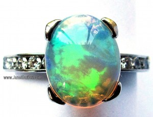 Opal ring with diamond shoulders