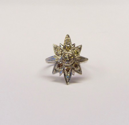 1 carat star ring £2,650, hand carved,18ct white gold set with approx 1 carat of wonderful rich brown and golden diamonds. 22mm by 20mm